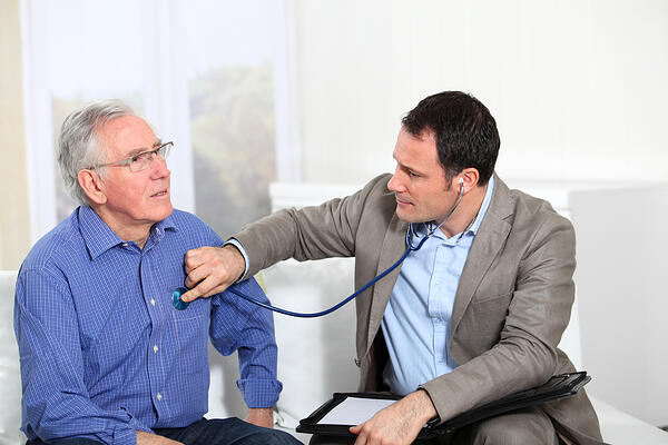 Doctor examining elderly man's health-2