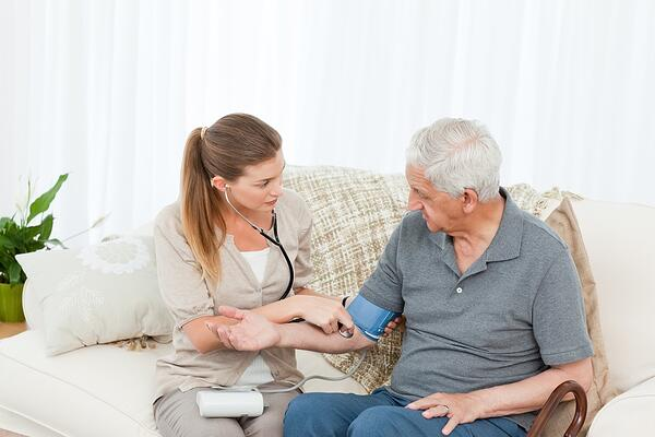 Nurse Care Manager helping her patient or client to stay healthy at home